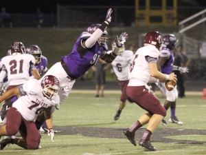 Senior DJ Williams beats two blockers to make a play on the A&M Consolidated quarterback.