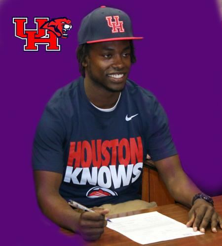 Terry Mark signs his letter of intent to play football at the University of Houston.