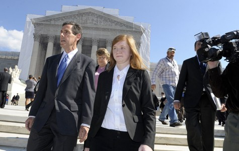 Abigail Fisher, the Texan involved in the University of Texas affirmative action case, and Edward Blum, who runs a group working to end affirmative action, walk outside the Supreme Court in Washington, Wednesday, Oct. 10, 2012. The Supreme Court is taking up a challenge to a University of Texas program that considers race in some college admissions. The case could produce new limits on affirmative action at universities, or roll it back entirely. (AP Photo/Susan Walsh)