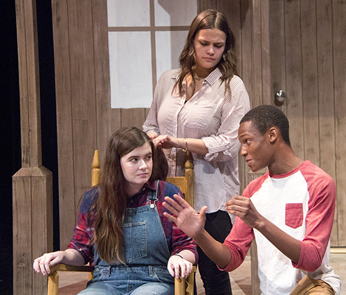 Tolu Ojuri, right, Paige Hoeleyn, standing and Rebecca Hill rehearse a seen for the LHS theater production of Oklahoma.