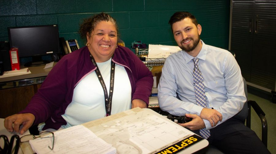 Administrative Assistant Aida Cavazos, left, and Assistant Principal of Student Activities Zachary Allen have moved into the office where longtime Student Activities Director Patricia White worked before her retirement earlier this year. (Photo by EBONY TATMON/Lufkin High School Panther Growls)