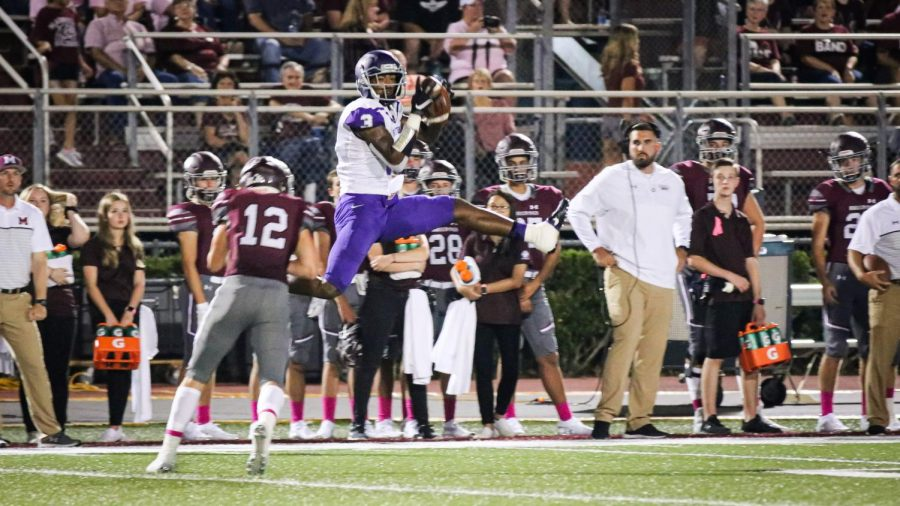 Lufkin Panthers receiver Ja'Lynn Polk goes up to try to make a catch during the Pack's 24-18 victory in Magnolia on Friday night. (Photo by DAYSHIA RUNNELS/Lufkin High School Fang Yearbook)