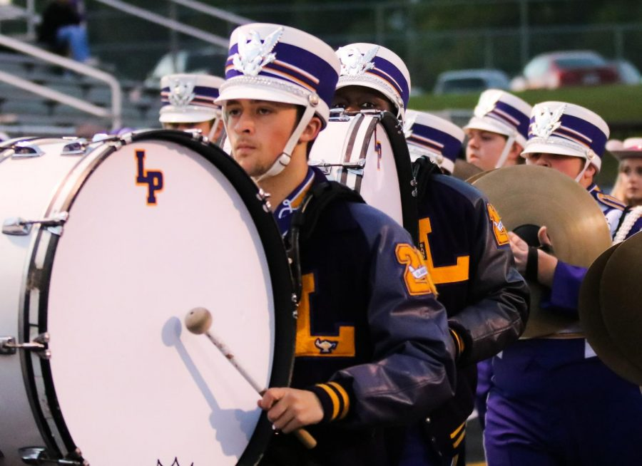 Lufkin High School senior Carson Camp marches into Abe Martin Stadium with the rest of the Panther Band before a recent football game. (Photo by NILLAH ALEXANDER/Lufkin High School Fang Yearbook)