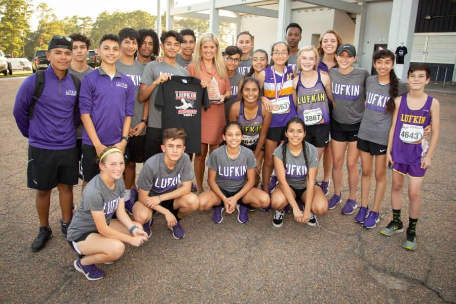 Lufkin High School's cross country teams recognize Lynne Haney, president of Lufkin Coca-Cola, this past week for the company's ongoing sponsorship of the Lufkin Coke Classic cross country meet. (Photo by ANDY ADAMS/Lufkin ISD)