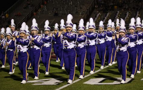 Members of Lufkin High School's Panther Band march during halftime of a recent football game. (Photo by DAYSHIA RUNNELS/Lufkin High School Fang Yearbook)