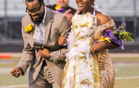 Kaelin Morris and her father, Kendrick, react as she is named the queen at Abe Martin Stadium. (Photo by NILLAH ALEXANDER/Lufkin High School Fang Yearbook)