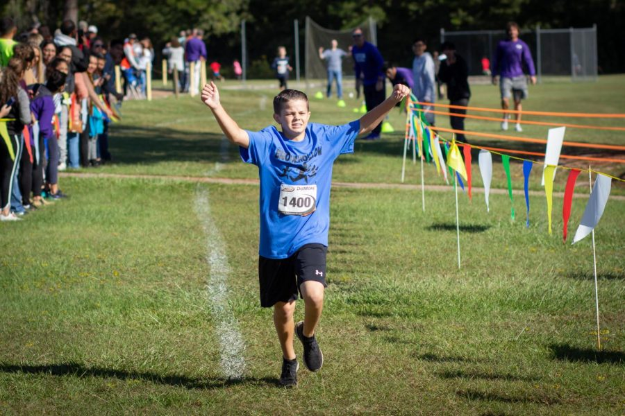 Brrokhollow Elementary fifth-grader Grant Stafford crosses the finish line of the sixth annual Run of the Panthers, held Wednesday morning at Lufkin High School. (Photo by WILL LANIGAN/Lufkin High School Panther Growls Editor.)
