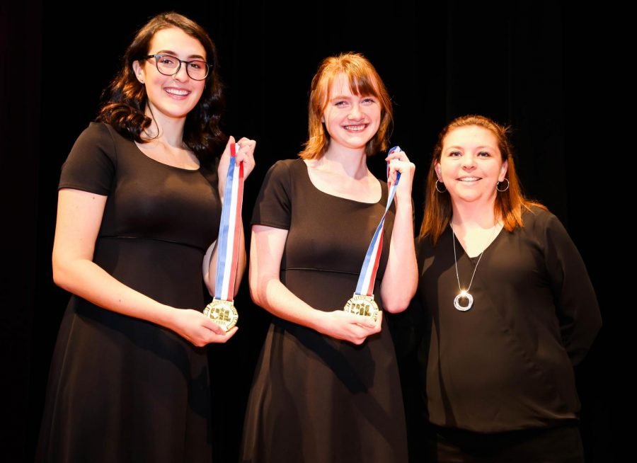 Lufkin High School junior Emma Carlile, left, and senior Paige Hoelewyn were recognized during the fall choir concert by LHS Choir Director Nicole Stewart, right, for the Outstanding Performer awards they received at the state UIL Choir and Ensemble competition earlier this year. (Photo by ANDY ADAMS/Lufkin ISD)