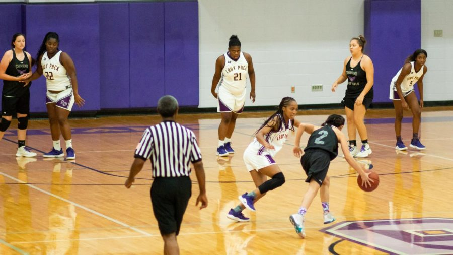 Members of the Lufkin High School varsity girls basketball team play defense during a recent scrimmage against Silsbee in Panther Gymnasium on the Lufkin Middle School campus. (Photo by NATALEE BATES/Lufkin High School Fang Yearbook)