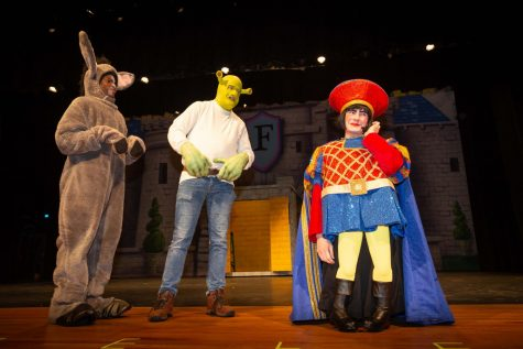 "Tolu O'jori (as Donkey), Graham Childers (as Shrek) and Alex Hill rehearse a scene for ""Shrek the Musical"" in the Tom Jack Lucas Auditorium. (Photo by ANDY ADAMS/Lufkin ISD)"