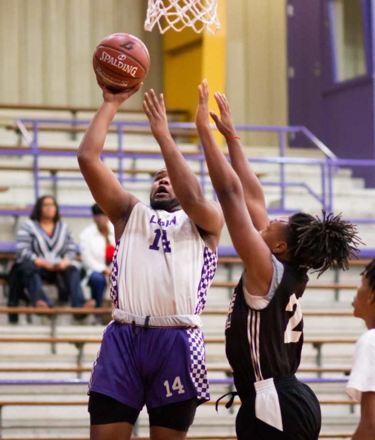 Senior Natron Wortham attacks the basket during a recent home game. (Photo by DAYSHIA RUNNELS/Lufkin High School Fang Yearbook)
