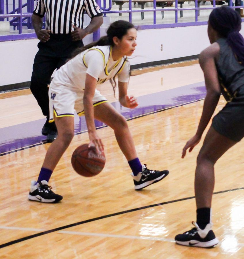 Lufkin High School freshman Alecia Rivera dribbles the ball between her legs during the Lady Panthers' 41-26 victory over Nacogdoches on Tuesday night in Panther Gymnasium on the Lufkin Middle School campus. (Photo by DESTINI DODD/Lufkin High School Student Media)