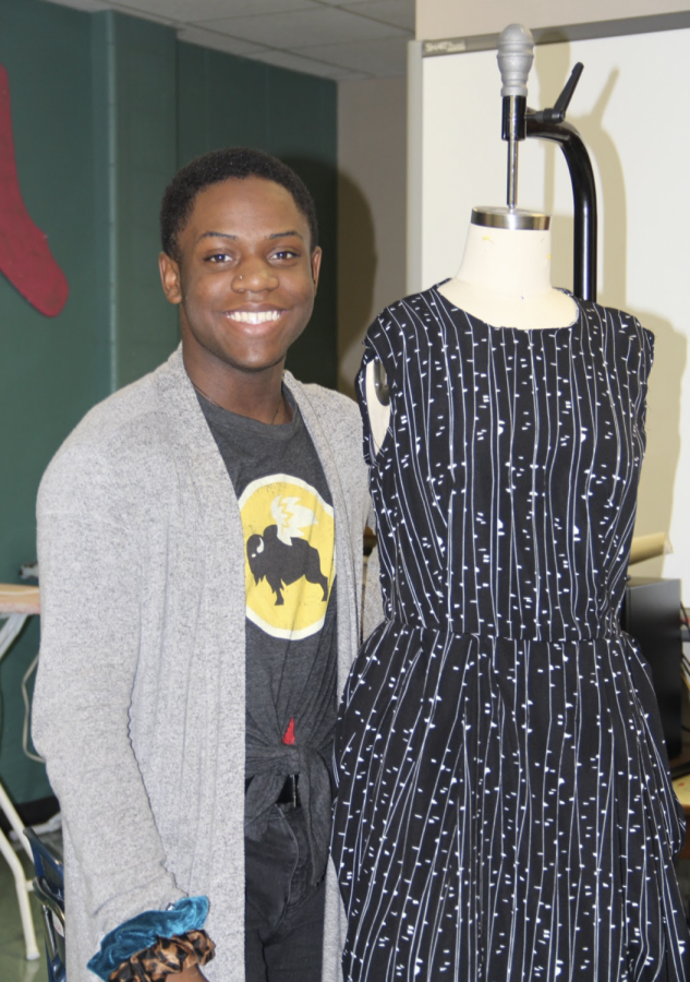 Lufkin High School Fashion Design student Brenden Flakes shows off the dress that he and his partner, Itzel Silva, designed for the FCCLA competition in Waco this past weekend. (Photo by SULMA LANDERO/Lufkin High School Student Media)