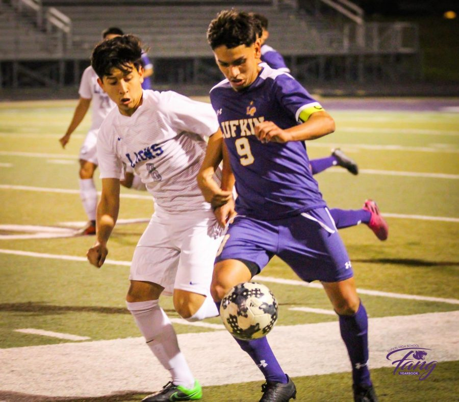 Lufkin High School junior Luis Flores controls the ball during the Panthers' 4-0 district win over John Tyler on Friday night in Abe Martin Stadium. Flores scored a hat trick in the first half of the match. (Photo by JHOSSELYN AMADOR/Lufkin High School Student Media)