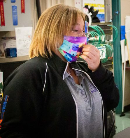 Lufkin High School technology teacher Robyn Segrest adjusts her mask in her classroom. (Photo by LUIS IBARRA/Lufkin High School Student Media)