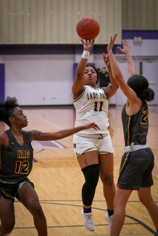 Junior Tori Coleman shoots in the lane during the Lady Pack's 46-30 district win over Nacogdoches this past Friday night in Panther Gymnasium on the Lufkin Middle School campus. (Photo by ANDY ADAMS/	LUFKIN ISD)