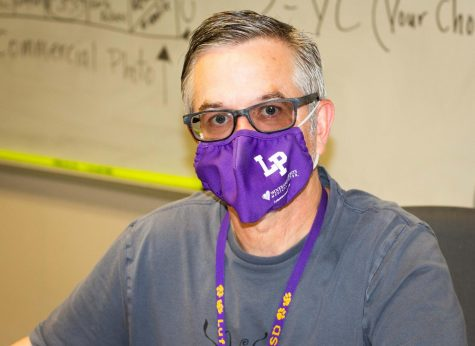 Photography teacher Sean Dupré is retiring after 20 years on the job at Lufkin High School. (Photo by ABIGAIL PALACIOS/Lufkin High School Student Media)